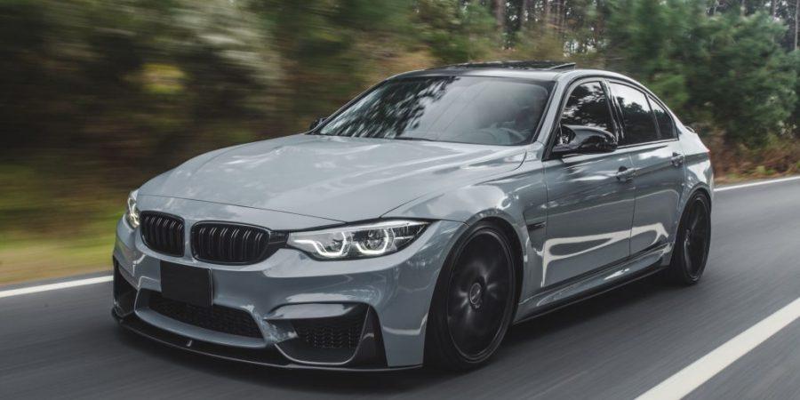 silver-metallic-color-sport-sedan-road-min